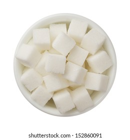 Sugar cubes in a bowl isolated on white background