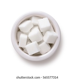 Sugar cubes in white bowl shot directly above isolated on white background with clipping path