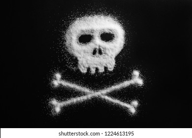 Sugar in the form of a skull and bones. Concept that sugar and sweets are dangerous or cocaine and drugs are fatal deadly and dangerous.