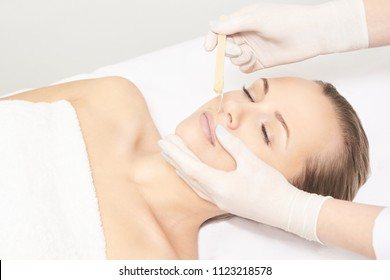 Sugar hair removal from woman body. Wax epilation spa procedure. Procedure beautician female. Mustache.
