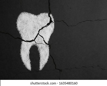 Sugar harms the tooth enamel. Image of a cracked sugar tooth on a black background. Concept of dental medicine.
