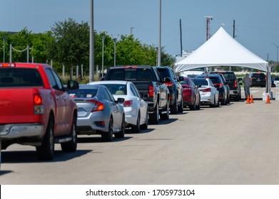 Sugar Land, Texas - April 16, 2020: Cars line up at city COVID-19 drive-through testing center