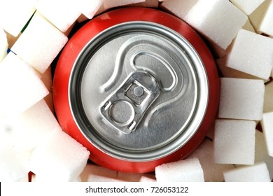 Sugar overdose in soft drinks with red soda can surrounded by white sugar cubes