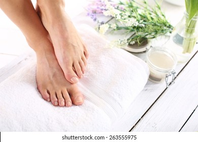 Sugar paste, care of female legs. Beautiful feet of a woman during treatments.