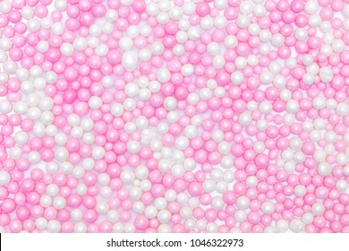 sugar pearls background, colored white and pink, concept bakery and toppings