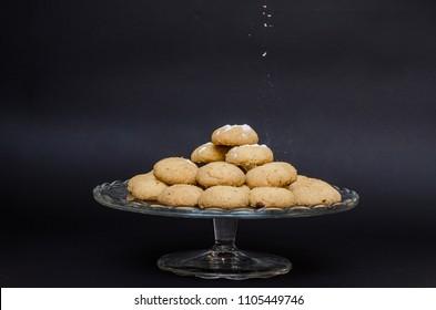 Sugar powder falling on top of Kahk (traditional Arabian cookies )