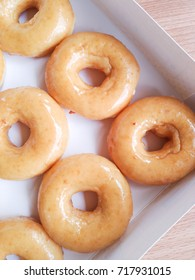 Sugar ring donuts in plate on table.