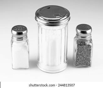 Sugar, salt, and pepper shakers.