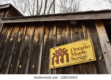 Sugar shack with the Ontario Maple Syrup Producers Association logo Kortright Centre for Conservation,  Woodbridge, Ontario, Canada - March 1, 2015
