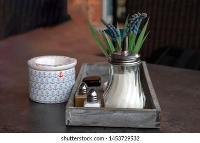 Sugar shaker, ashtray and table decoration