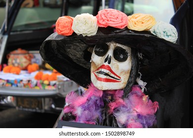 Sugar skull with old fashioned hat and flowers (Catrina) displayed during Day of the Dead celebration (Dia de los Muertos)