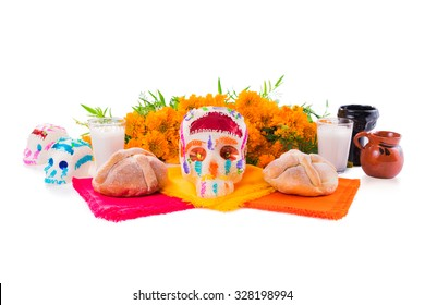 "sugar skull used for ""dia de los muertos"" celebration isolated on white with cempasuchil flowers"
