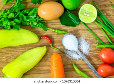 Sugar in a spoon of food clean eating selection placed on a wooden table.