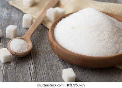 sugar in spoon and plate.