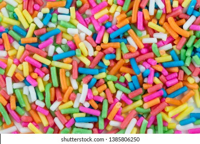 Sugar sprinkle dots background and texture, rainbow sugar decoration for cake,bekery and ice cream.