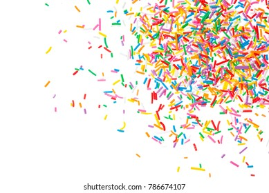 Sugar sprinkle dots hearts, decoration for cake and bakery, as a background. Isolated on white. Easter background