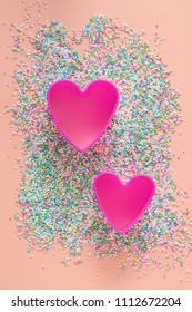 sugar sprinkles and two pink hearts