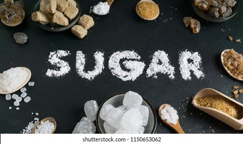 Sugar variation set on dark stone background with word sugar. Brown and white, crystal and cane sugar