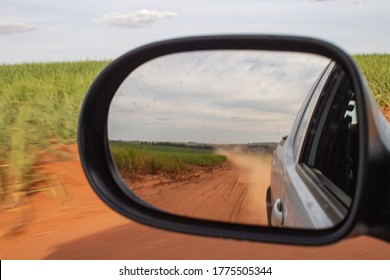 Sugarcane seen from the space of a car