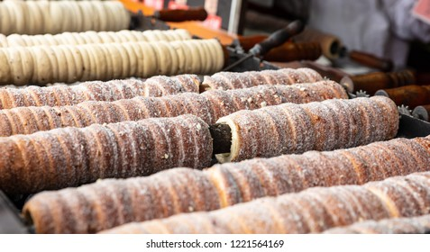 Sugarcoated rolls, traditional sweet pastry, street food, Trdelnik, Prague, Czech Republic. Closeup view