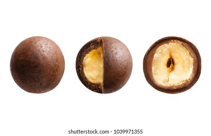 Sugared hazelnut dragees in chocolate isolated on white background. Chocolate balls candy filled with nut