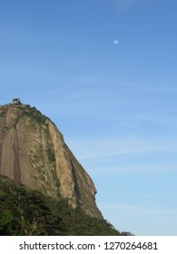 Sugarloaf Mountain, moon and blue sky