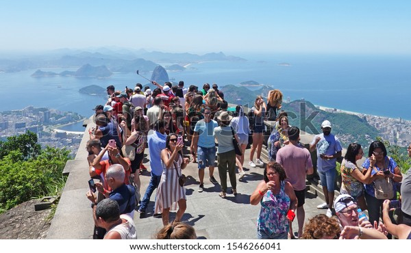 Sugarloaf mountain, Rio De Janeiro, Brazil 2019.  Tourists flocking to see the view from Corcavado which overlooks sugarloaf mountain.  This is a major attraction in Rio, and is popular all year round