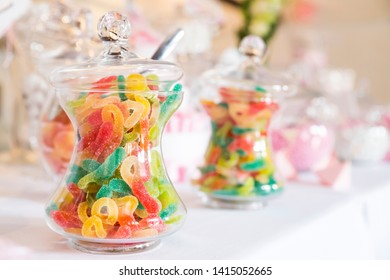 Sugary gummy candies in a glass container