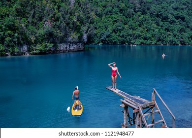 Sugba lagoon, tourists attraction. SUP Stand up paddle board. Blue sea lagoon, National Park, Siargao Island, Philippines.