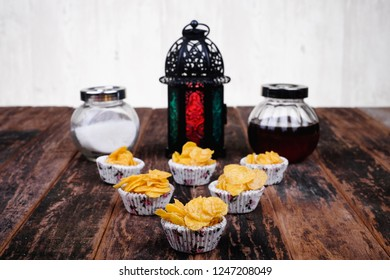 Suger, lantern, conrflakes cup, honey on  wooden background