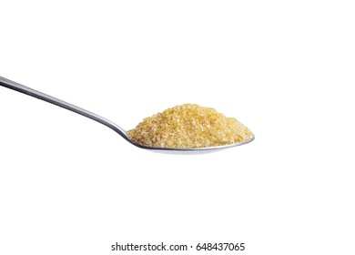 Suger on a metal spoon isolated on a black background