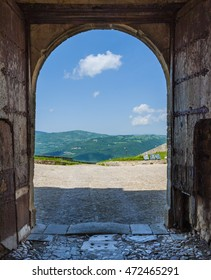 Suggestive panoramic view of the southern Apennines through the door of the Cattle castles. Puglia, Italy.