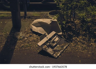 Suginami City, Tokyo, JAPAN - May 13th, 2020: Along the Koshukaido road, a broken personal computer has been thrown on the ground with other garbages.