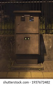 Suginami City, Tokyo, JAPAN - May 13th, 2020: Along the Koshukaido road, an old Electric Distribution service transformer in the darkness of the night in Tokyo.