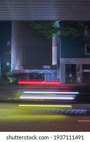"""Suginami, Tokyo,  JAPAN - May 30th, 2020: Night view of the road called """"koshukaido"""" with light trails of passing in front of the KORG G-Roks Studios."""