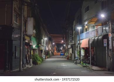 Suginami, Tokyo,  JAPAN - May 31st, 2020: Night view of the back street empty near the Sakurajosui Station with koshukaido and the Tokyo Expressway in the background.