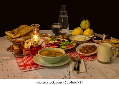 Suhoor-Sahur meal  is an Islamic term referring to the meal consumed early in the morning by Muslims before fasting, during of Ramadan. Long Exposure taken of keep satiate foods all day on the table.