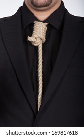 Suicidal businessman with noose around his neck with black suit