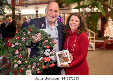 Suisun City, California / USA - November 29, 2019: This man made a highly charitable donation to the Fisher House and was awarded a 'Minnie Mouse Wreath' and box of cookies to help celebrate