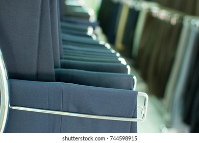 suit pant with different tone on hangers garment in the tailor shop
