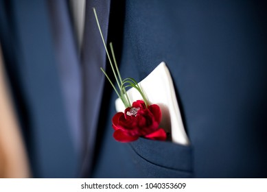 suit with rose buttonhole