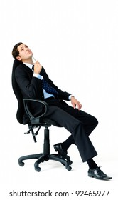 Suit wearing businessman ponders and looks overhead while holding a pen