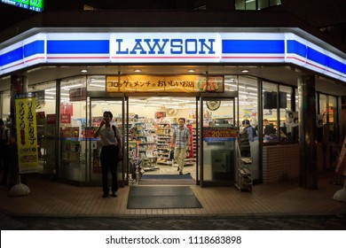 Suita, Japan - June 22, 2018: Customers in front of Lawson convenience store at night
