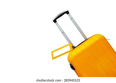 Suitcase with blank label at airport.