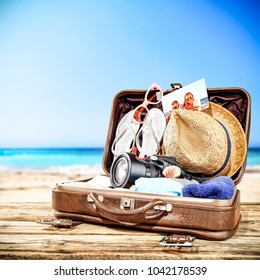 Suitcase of brown color and summer time. Free space for your decoration.