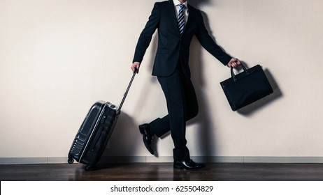 Suitcase and businessman, business trip
