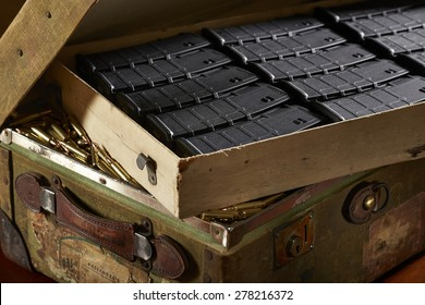 Suitcase of gun magazines and bullets