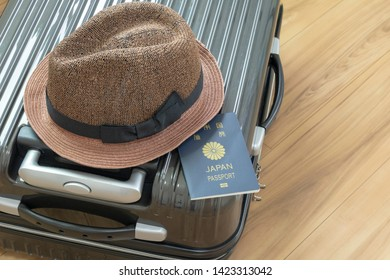 Suitcase and hat and travel image