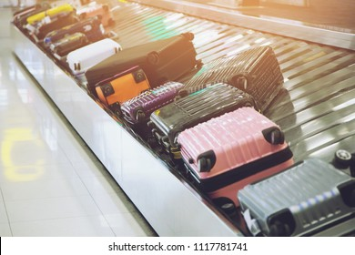 Suitcase or luggage with Circulating conveyor belt in the baggage claim in the international airport.