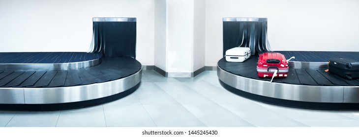 Suitcase or luggage is conveyed through the conveyor belt in arrivals lounge of airport terminal - Image